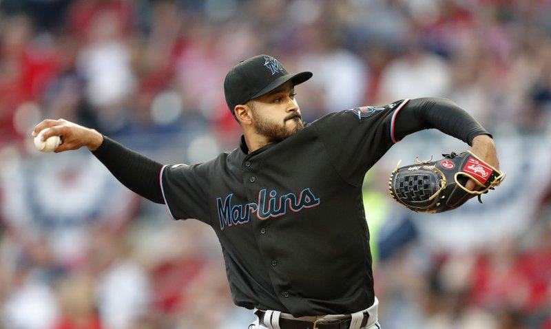Miami Marlins starting pitcher Pablo Lopez works in the first inning of baseball game against the Atlanta Braves,Friday, April 5, 2019, in Atlanta. (AP Photo/John Bazemore)