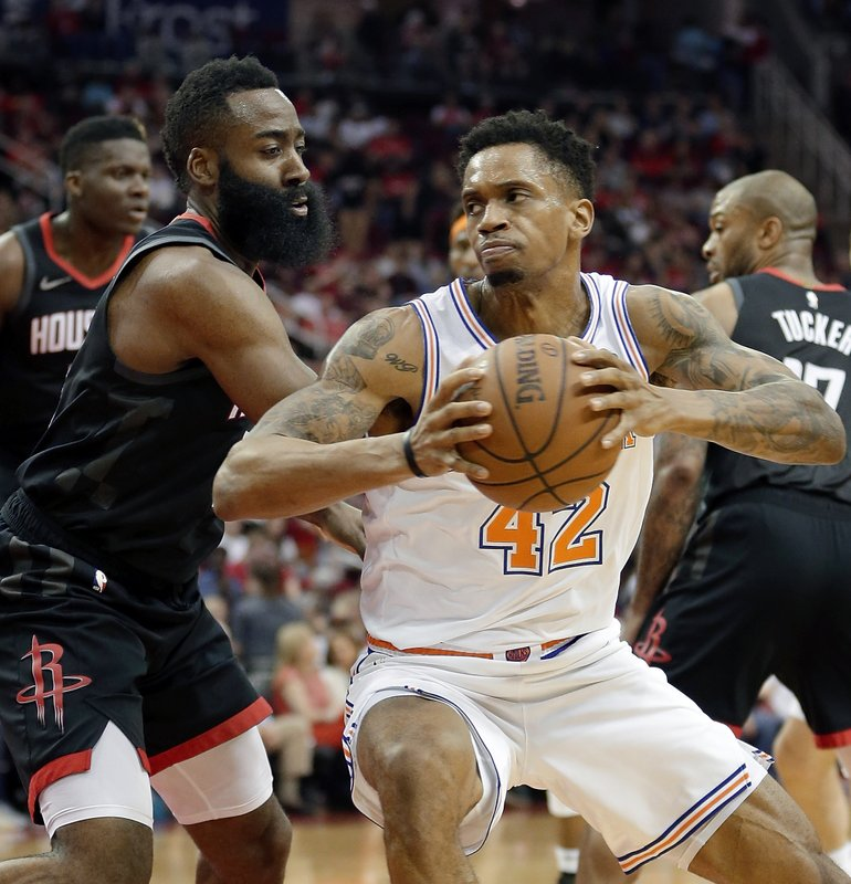 New York Knicks forward Lance Thomas (42) looks for a shot around Houston Rockets guard James Harden during the first half of an NBA basketball game Friday, April 5, 2019, in Houston. (AP Photo/Michael Wyke)