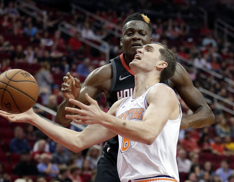 New York Knicks forward Mario Hezonja (8) loses the ball as he drives to the basket under pressure from Houston Rockets center Clint Capela during the first half of an NBA basketball game Friday, April 5, 2019, in Houston. (AP Photo/Michael Wyke)