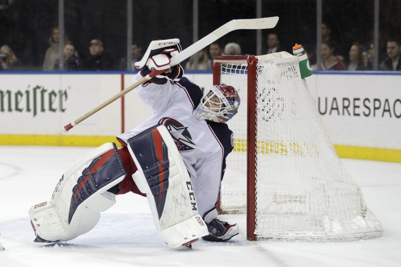 Columbus Blue Jackets goaltender Sergei Bobrovsky, of Russia, tries to keep his balance while defending against the New York Rangers during the second period of an NHL hockey game Friday, April 5, 2019, in New York. (AP Photo/Julio Cortez)