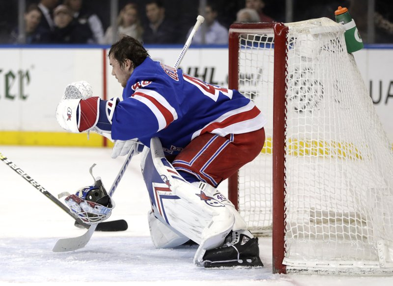 New York Rangers goaltender Alexandar Georgiev, of Bulgaria, loses his mask while defending against the Columbus Blue Jackets during the first period of an NHL hockey game, Friday, April 5, 2019, in New York. (AP Photo/Julio Cortez)
