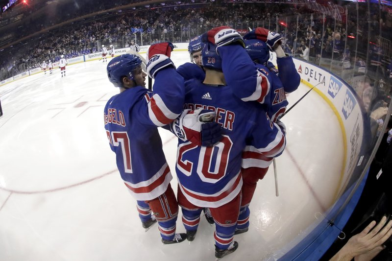 New York Rangers left wing Chris Kreider (20) celebrates his second-period goal with teammates during an NHL hockey game against the Columbus Blue Jackets, Friday, April 5, 2019, in New York. (AP Photo/Julio Cortez)