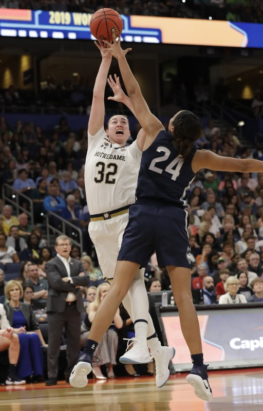 Notre Dame forward Jessica Shepard (32) shoots as Connecticut forward Napheesa Collier (24) defends during the first half of a Final Four semifinal of the NCAA women's college basketball tournament Friday, April 5, 2019, in Tampa, Fla. (AP Photo/Chris O'Meara)