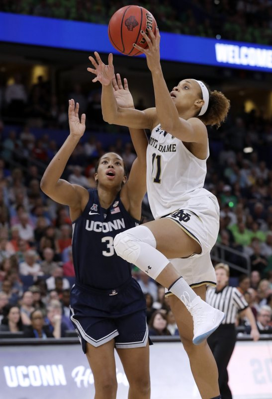 Notre Dame forward Brianna Turner (11) drives to the basket as Connecticut guard Megan Walker (3) defends during the first half of a Final Four semifinal of the NCAA women's college basketball tournament Friday, April 5, 2019, in Tampa, Fla. (AP Photo/Chris O'Meara)