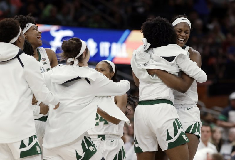 Baylor center Kalani Brown hugs forward NaLyssa Smith, right, as teammates celebrate on the court during the second half against Oregon in a Final Four semifinal of the NCAA women's college basketball tournament Friday, April 5, 2019, in Tampa, Fla. (AP Photo/Chris O'Meara)