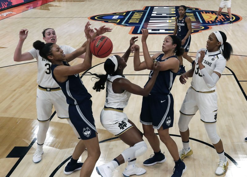 CORRECTS TO FIRST HALF - Notre Dame's Jessica Shepard, left, Connecticut's Napheesa Collier, second from left and others fight for a loose ball during the first half of a Final Four semifinal of the NCAA women's college basketball tournament Friday, April 5, 2019, in Tampa, Fla. (AP Photo/John Raoux)