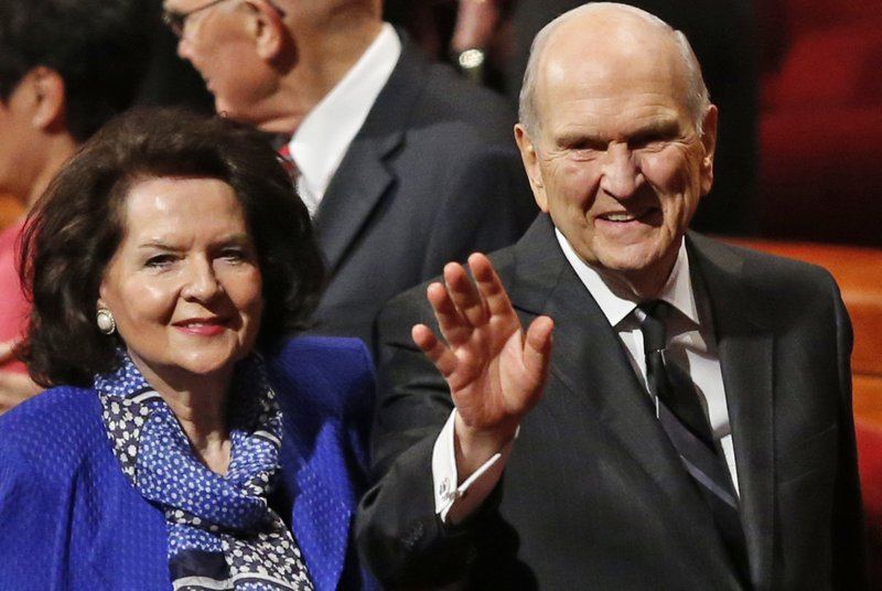 FILE - In this Oct. 6, 2018, file photo, President Russell M. Nelson and his wife, Wendy, wave as they leave the morning session of a twice-annual conference of The Church of Jesus Christ of Latter-day Saints in Salt Lake City. (AP Photo/Rick Bowmer, File)