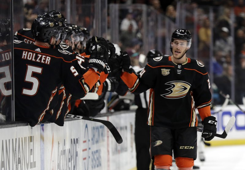 Anaheim Ducks' Carter Rowney, right, celebrates his goal with teammates on the bench during the first period of an NHL hockey game against the Los Angeles Kings on Friday, April 5, 2019, in Anaheim, Calif. (AP Photo/Marcio Jose Sanchez)