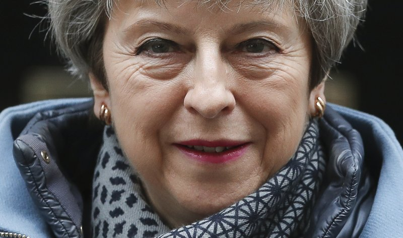 FILE - In this March 27, 2019, file photo, Britain's Prime Minister Theresa May leaves 10 Downing Street to attend her weekly Prime Minster's Questions at the House of Commons, in London. (AP Photo/Alastair Grant, File)
