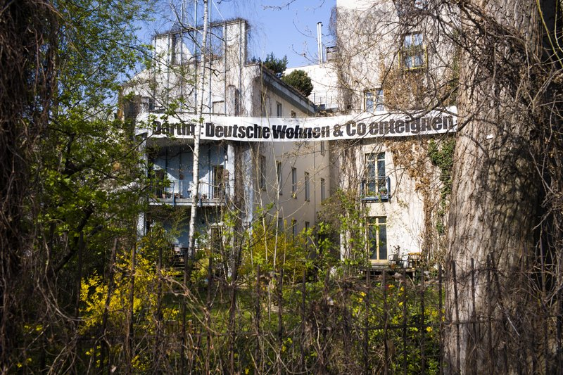 A protest banner reading : 'Therefore: Expropriate Deutsche Wohnen and Co' displayed at an apartment buildings in the district Kreuzberg in Berlin, Germany, Thursday, April 4, 2019. (AP Photo/Markus Schreiber)