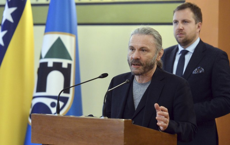 Bruce Dickinson speaks at the city hall in Sarajevo, Bosnia-Herzegovina, Saturday, April 6, 2019. Bosnia's capital Sarajevo has declared Iron Maiden lead singer Bruce Dickinson an honorary citizen in gratitude for the concert the heavy metal band held while the city was under siege during 1992-95 war. (AP Photo/Eldar Emric)