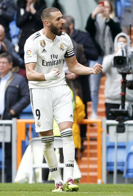 Real Madrid's Karim Benzema celebrates after he scored his side's second goal during a Spanish La Liga soccer match between Real Madrid and Eibar at the Santiago Bernabeu stadium in Madrid, Spain, Saturday April 6, 2019. (AP Photo/Paul White)