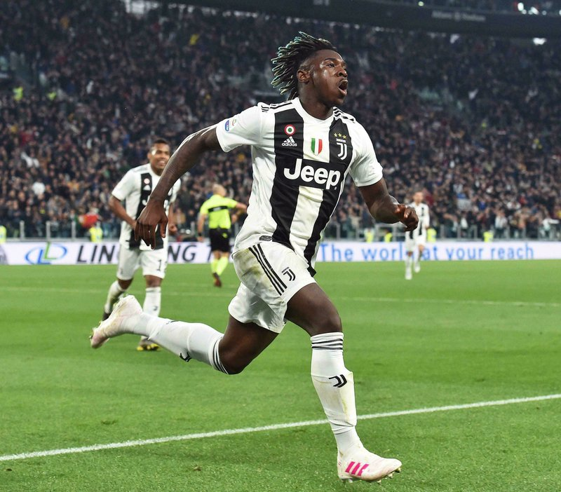 Juventus' Moise Kean celebrates after scoring his team's second goal during the Italian Serie A soccer match between Juventus and AC Milan at the Allianz Stadium in Turin, Italy, Saturday, April 6, 2019. (Andrea Di Marco/ANSA via AP)