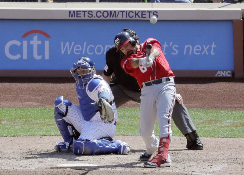 Washington Nationals' Anthony Rendon hits a double off New York Mets relief pitcher Robert Gsellman during the sixth inning of a baseball game, Saturday, April 6, 2019, in New York. (AP Photo/Julio Cortez)