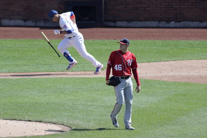 Washington Nationals starting pitcher Patrick Corbin (46) looks on as New York Mets' Michael Conforto runs the bases after hitting a solo home run off him during the sixth inning of a baseball game, Saturday, April 6, 2019, in New York. (AP Photo/Julio Cortez)