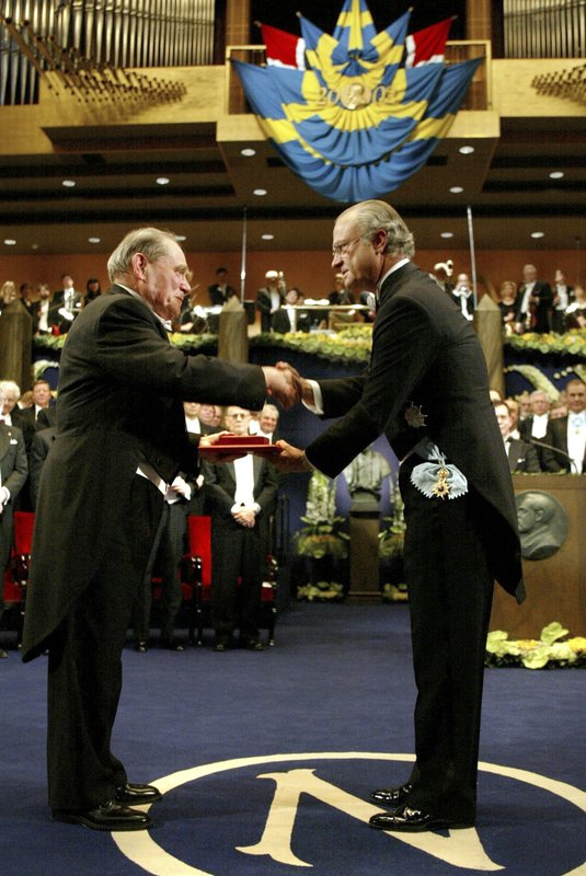 FILE - In this Monday, Dec. 10, 2002, file photo, Dr. Sydney Brenner of South Africa, left, receives the Nobel Prize in Medicine from King Carl Gustaf of Sweden, right, during a ceremony at the Concert Hall in Stockholm, Sweden. (AP Photo/Henrik Montgomery/Pool, File)