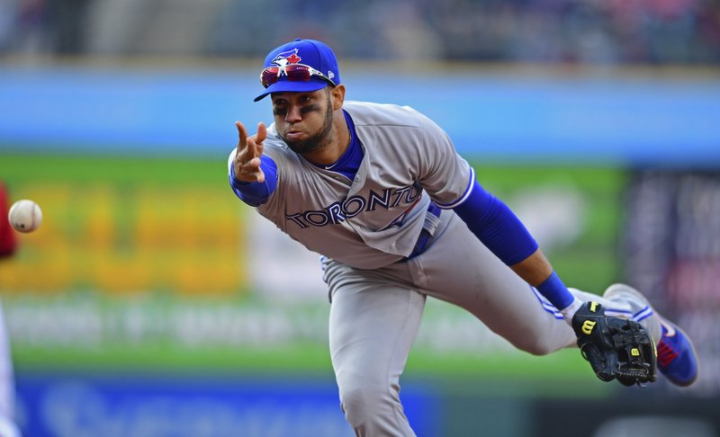 Toronto Blue Jays' Lourdes Gurriel Jr. flips the ball to first base to get out Cleveland Indians' Jake Bauers in the sixth inning of a baseball game, Saturday, April 6, 2019, in Cleveland. (AP Photo/David Dermer)