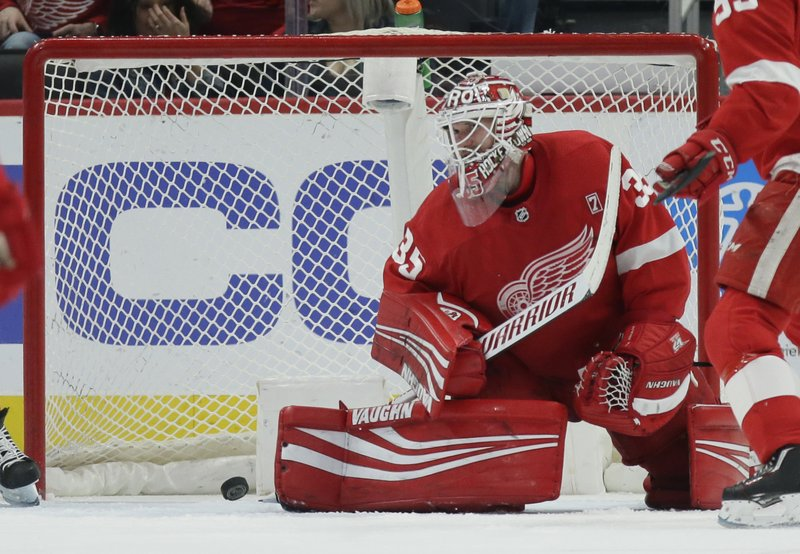 Detroit Red Wings goaltender Jimmy Howard (35) cannot stop a shot by Buffalo Sabres left wing Conor Sheary during the second period of an NHL hockey game Saturday, April 6, 2019, in Detroit. (AP Photo/Duane Burleson)