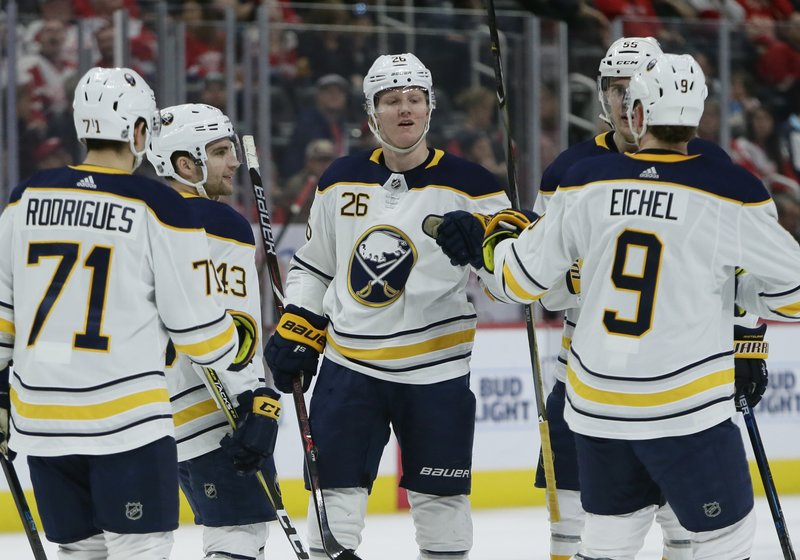 Buffalo Sabres defenseman Rasmus Dahlin (26), of Sweden, celebrates with teammates after scoring against the Detroit Red Wings during the first period of an NHL hockey game Saturday, April 6, 2019, in Detroit. (AP Photo/Duane Burleson)