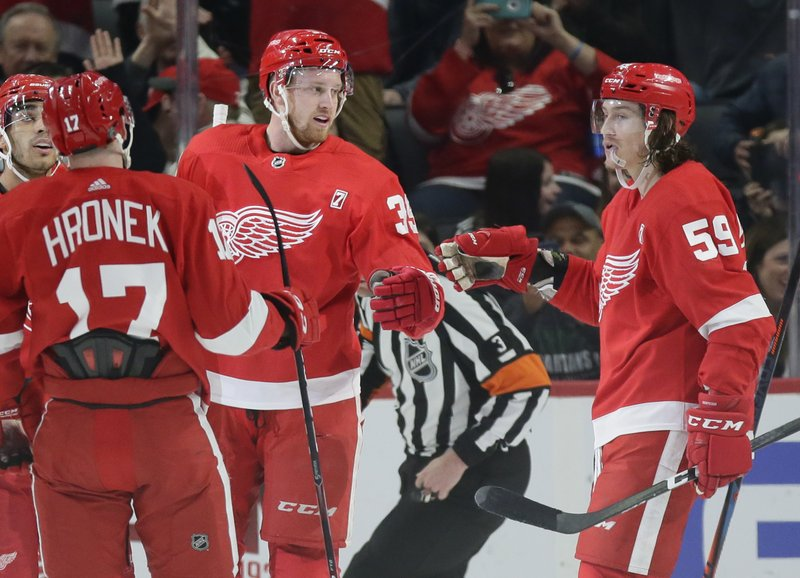 Detroit Red Wings right wing Anthony Mantha (39) celebrates his goal against the Buffalo Sabres with left wing Tyler Bertuzzi (59) and defenseman Filip Hronek (17), of the Czech Republic, during the first period of an NHL hockey game Saturday, April 6, 2019, in Detroit. (AP Photo/Duane Burleson)