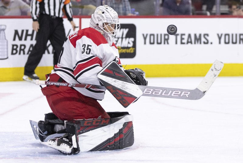 Carolina Hurricanes' Curtis McElhinney keeps his eyes on the puck after making a save during the second period of the team's NHL hockey game against the Philadelphia Flyers, Saturday, April 6, 2019, in Philadelphia. (AP Photo/Chris Szagola)
