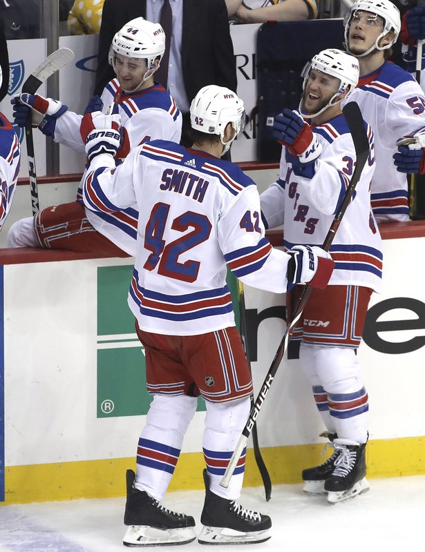 New York Rangers' Brendan Smith (42) returns to the bench after scoring in the first period of an NHL hockey game against the Pittsburgh Penguins in Pittsburgh, Saturday, April 6, 2019. (AP Photo/Gene J. Puskar)