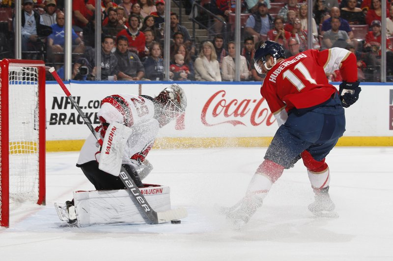 New Jersey Devils goaltender Mackenzie Blackwood, left, stop a shot by Florida Panthers Jonathan Huberdeau, right, during the first period of an NHL hockey game, Saturday, Apr. (AP Photo/Joel Auerbach)