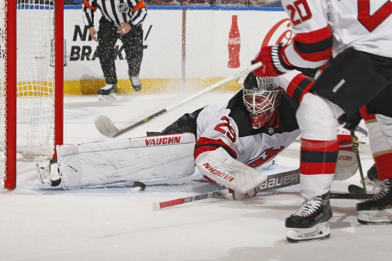 New Jersey Devils goaltender Mackenzie Blackwood (29) looks back as he makes a pad save against the Florida Panthers during the first period of an NHL hockey game, Saturday, April 6, 2019, in Sunrise, Fla. (AP Photo/Joel Auerbach