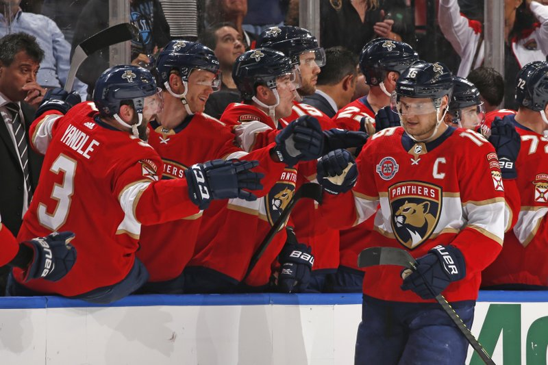 Teammates congratulate Florida Panthers center Aleksander Barkov (16) after he scored a goal against the New Jersey Devils during the second period of an NHL hockey game, Saturday, April 6, 2019, in Sunrise, Fla. (AP Photo/Joel Auerbach)