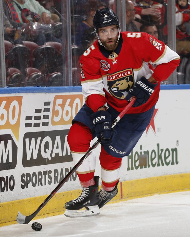 Florida Panthers defenseman Aaron Ekblad (5) clears the puck from behind the net during the second period of an NHL hockey game against the New Jersey Devils, Saturday, April 6, 2019, in Sunrise, Fla. (AP Photo/Joel Auerbach)