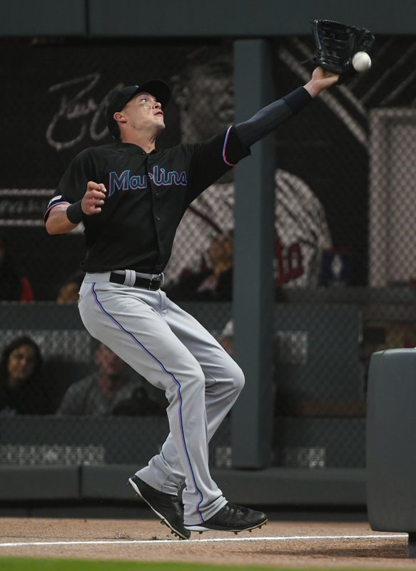Miami Marlins right fielder Peter O'Brien misses the catch on a foul ball by Atlanta Braves' Ronald Acuna Jr. (AP Photo/John Amis)