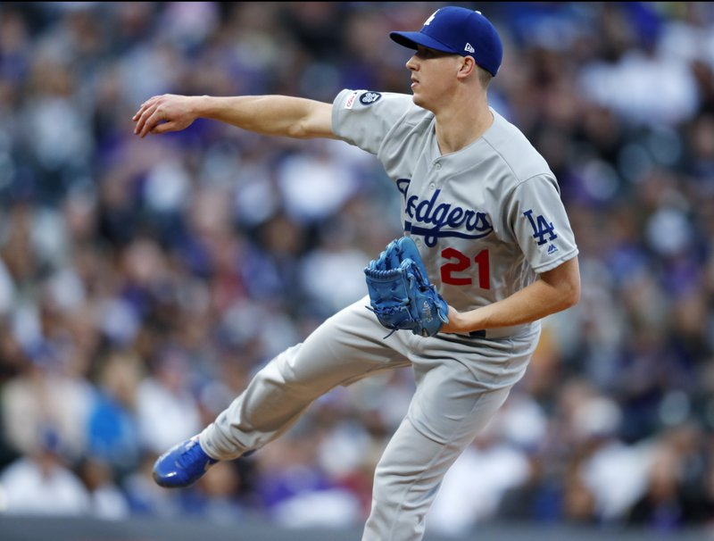Los Angeles Dodgers starting pitcher Walker Buehler works against the Colorado Rockies in the first inning of a baseball game Saturday, April 6, 2019, in Denver. (AP Photo/David Zalubowski)