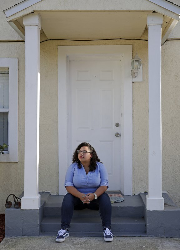 In this Thursday, March 28, 2019 photo Stephanie Loraine Pineiro reflects at her home in Orlando, Fla. (AP Photo/John Raoux)
