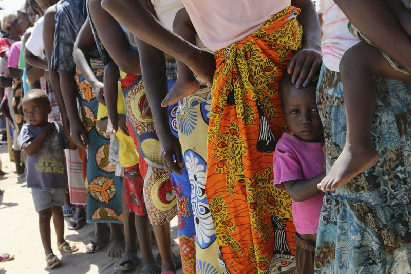 Women and children wait in a queue for oral cholera vaccinations, at a camp for displaced survivors of cyclone Idai in Beira, Mozambique, Wednesday, April 3, 2019. (AP Photo/Tsvangirayi Mukwazhi)