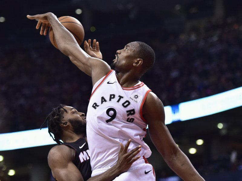 Toronto Raptors center Serge Ibaka (9) blocks a shot by Miami Heat forward Justise Winslow during second-half NBA basketball action in Toronto, Sunday, April 7, 2019. (Frank Gunn/The Canadian Press via AP)
