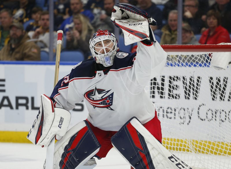 Columbus Blue Jackets goalie Sergei Bobrovsky makes a glove-save during the third period of an NHL hockey game against the Buffalo Sabres, Sunday, March 31, 2019, in Buffalo, N. (AP Photo/Jeffrey T. Barnes)