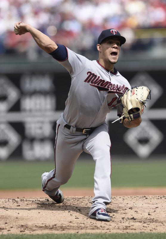Minnesota Twins' Jose Berrios pitches during the first inning of a baseball game against the Philadelphia Phillies, Sunday, April 7, 2019, in Philadelphia. (AP Photo/Michael Perez)