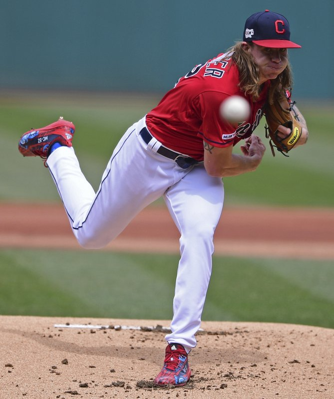 Cleveland Indians starting pitcher Mike Clevinger delivers in the first inning of a baseball game against the Toronto Blue Jays, Sunday, April 7, 2019, in Cleveland. (AP Photo/David Dermer)