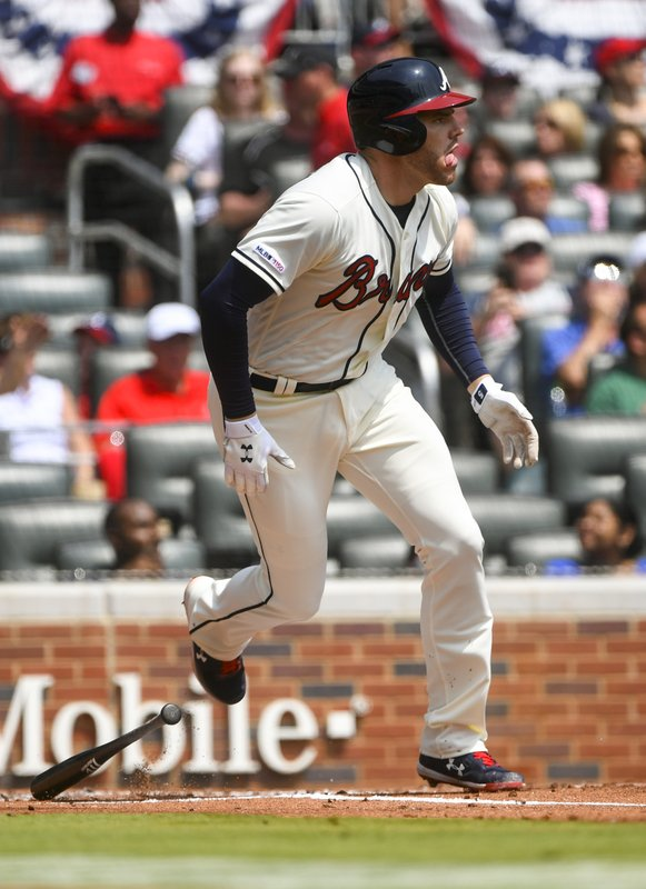 Atlanta Braves' Freddie Freeman watches his home run ball fly to center field during the first inning of a baseball game against the Miami Marlins, Sunday, April 7, 2019, in Atlanta. (AP Photo/John Amis)