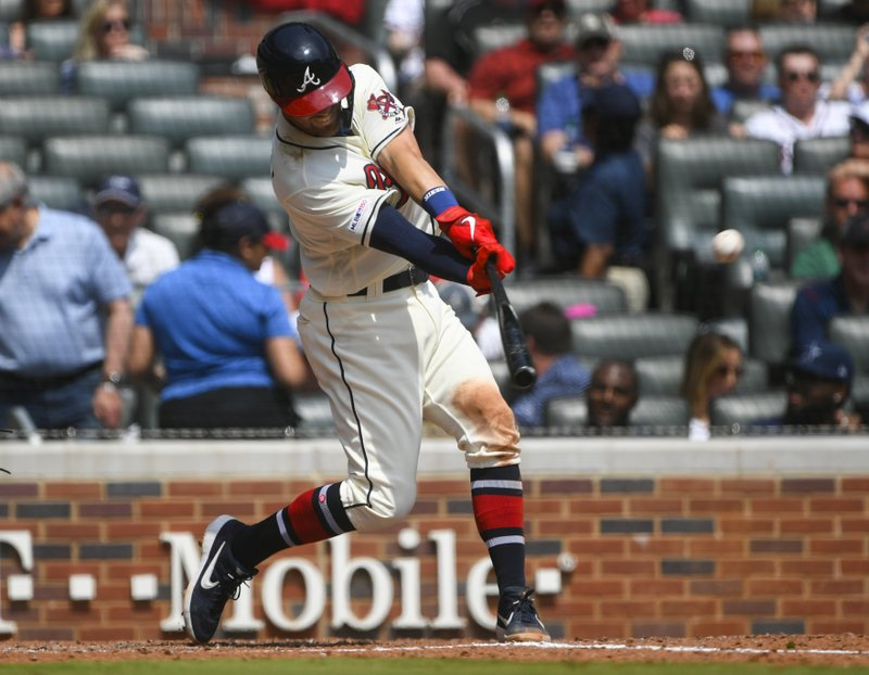 Atlanta Braves' Dansby Swanson hits a home run during the fourth inning of a baseball game against the Miami Marlins, Sunday, April 7, 2019, in Atlanta. (AP Photo/John Amis)