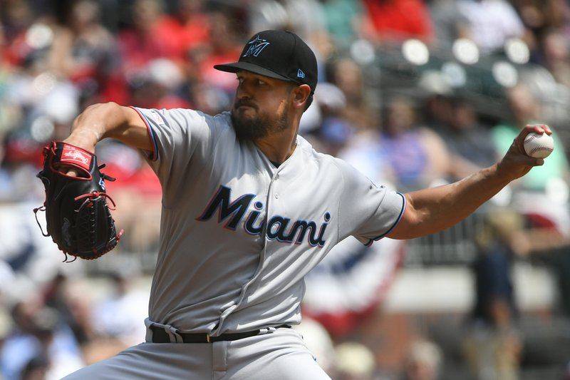 Miami Marlins' Caleb Smith pitches against the Atlanta Braves during the first inning of a baseball game Sunday, April 7, 2019, in Atlanta. (AP Photo/John Amis)