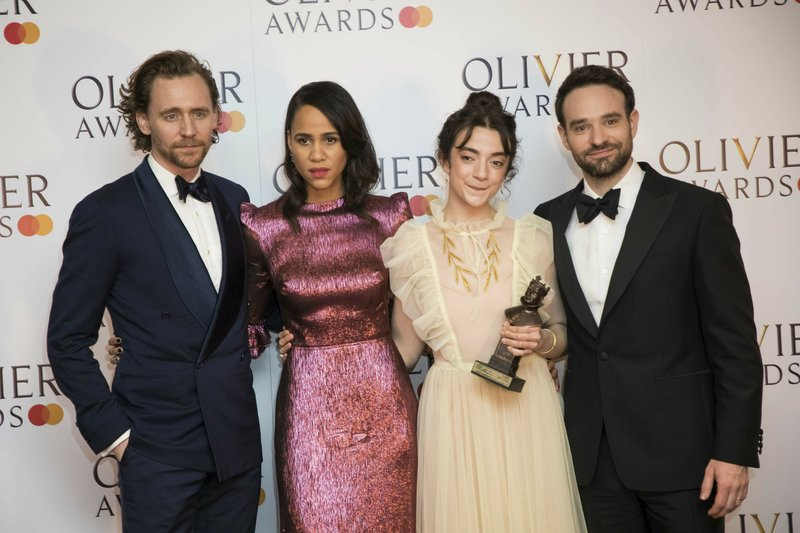 Actor Tom Hiddleston, from left, actors Zawe Ashton, Patsy Ferran and Charlie Cox pose for photographers backstage at the Olivier Awards in London, Sunday, April 7, 2019. (Photo by Vianney Le Caer/Invision/AP)