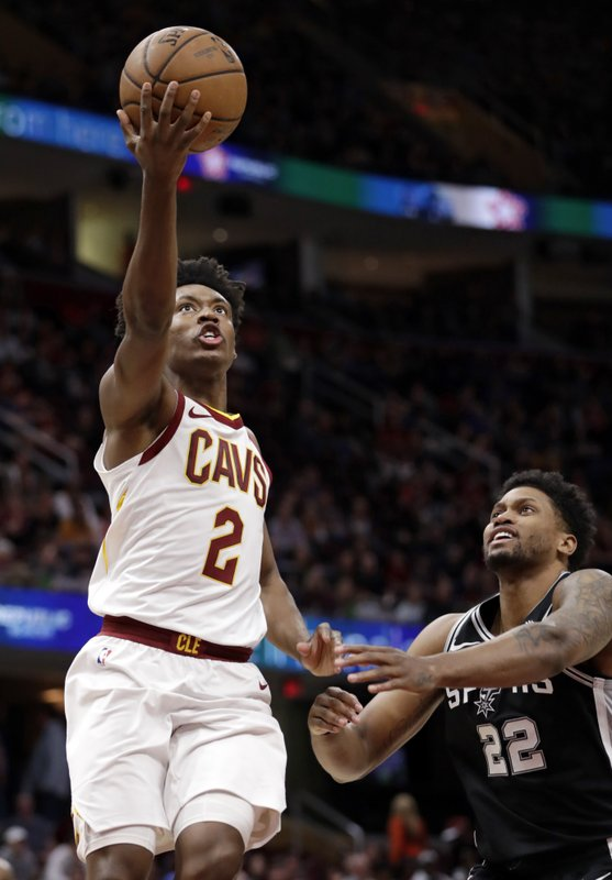 Cleveland Cavaliers' Collin Sexton (2) drives to the basket against San Antonio Spurs' Rudy Gay (22) in the first half of an NBA basketball game, Sunday, April 7, 2019, in Cleveland. (AP Photo/Tony Dejak)