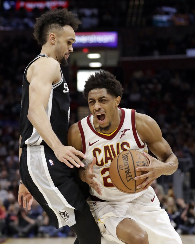 Cleveland Cavaliers' Brandon Knight, right, drives past San Antonio Spurs' Derrick White in the first half of an NBA basketball game, Sunday, April 7, 2019, in Cleveland. (AP Photo/Tony Dejak)