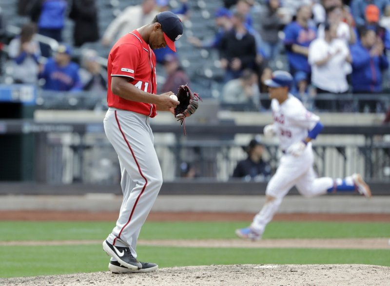Washington Nationals pitcher Joe Ross (41) reacts as New York Mets' Michael Conforto, back right, runs the bases after hitting a three run home-run during the ninth inning of a baseball game Sunday, April 7, 2019, in New York. (AP Photo/Frank Franklin II)