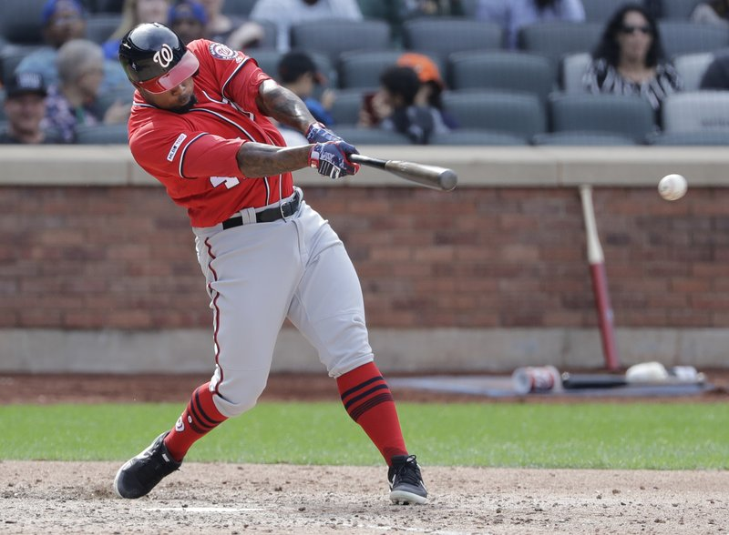 Washington Nationals' Howie Kendrick follows through on a single during the seventh inning of a baseball game against the New York Mets, Sunday, April 7, 2019, in New York. (AP Photo/Frank Franklin II)