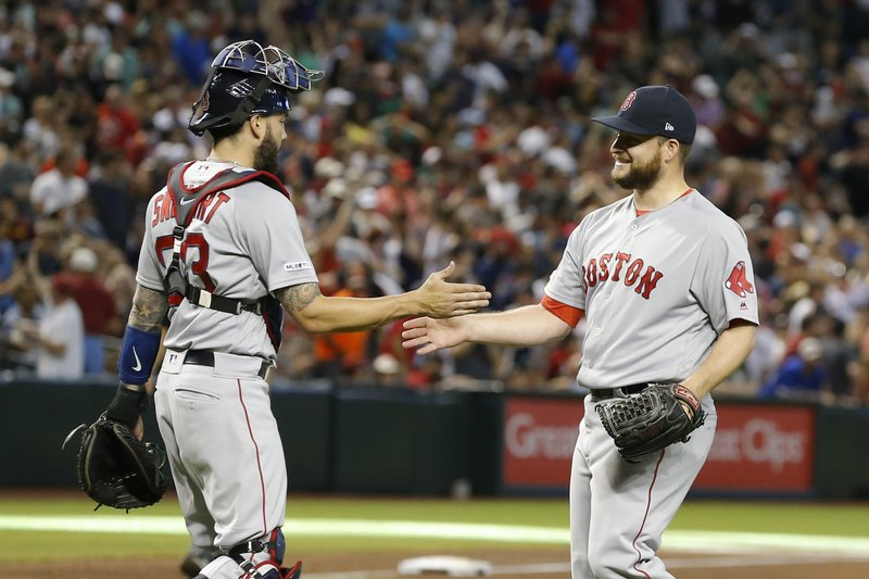 Boston Red Sox pitcher Ryan Brasier and Blake Swihart (23) celebrate after defeating the Arizona Diamondbacks 1-0 during a baseball game, Sunday, April 7, 2019, in Phoenix. (AP Photo/Rick Scuteri)