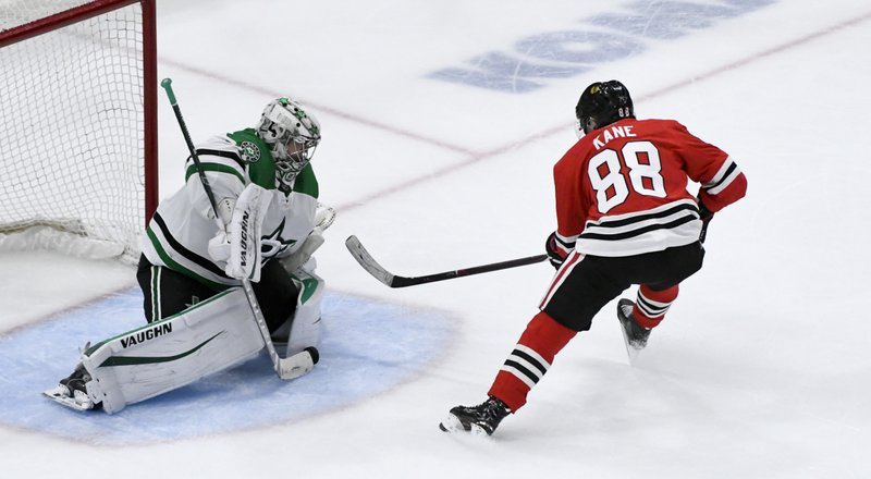 Chicago Blackhawks right wing Patrick Kane (88) scores a goal past Dallas Stars goaltender Anton Khudobin (35) during the third period of an NHL hockey game Friday, April 5, 2019, in Chicago. (AP Photo/Matt Marton)
