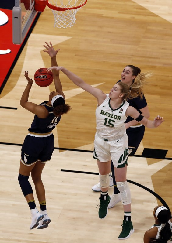 Baylor forward Lauren Cox (15) blocks a shot by Notre Dame forward Brianna Turner (11) during the first half of the Final Four championship game of the NCAA women's college basketball tournament, Sunday, April 7, 2019, in Tampa, Fla. (AP Photo/Mark LoMoglio)