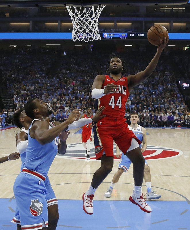 New Orleans Pelicans forward Solomon Hill, right, goes to the basket against Sacramento Kings forward Harrison Barnes during the first half of an NBA basketball game Sunday, April 7, 2019, in Sacramento, Calif. (AP Photo/Rich Pedroncelli)